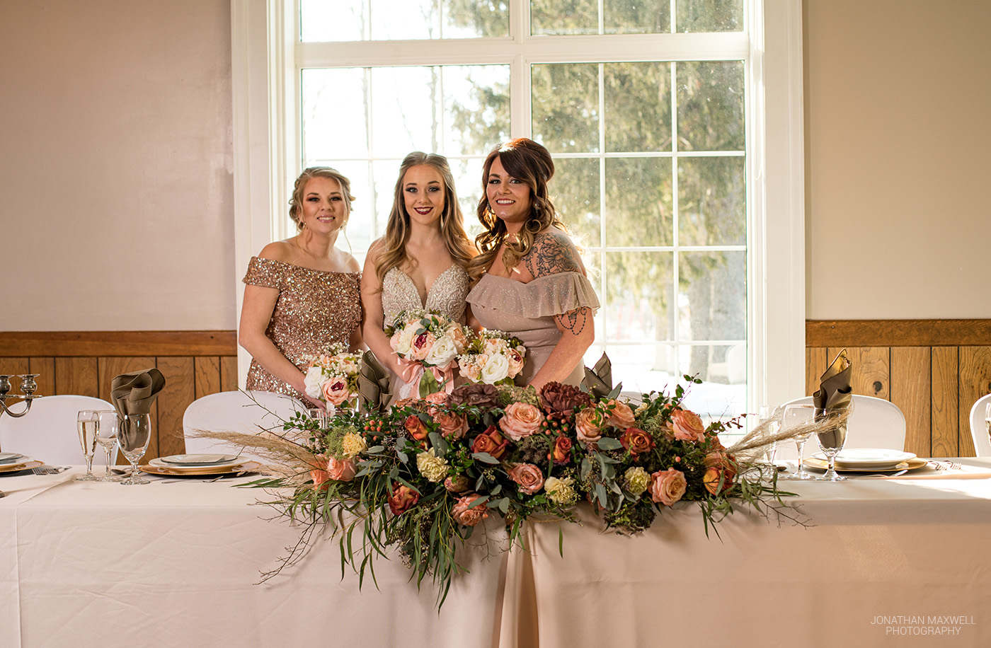 Bride and bridesmaid in front of beautiful window