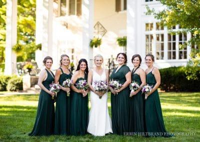 bride and bridesmaids mansion exterior