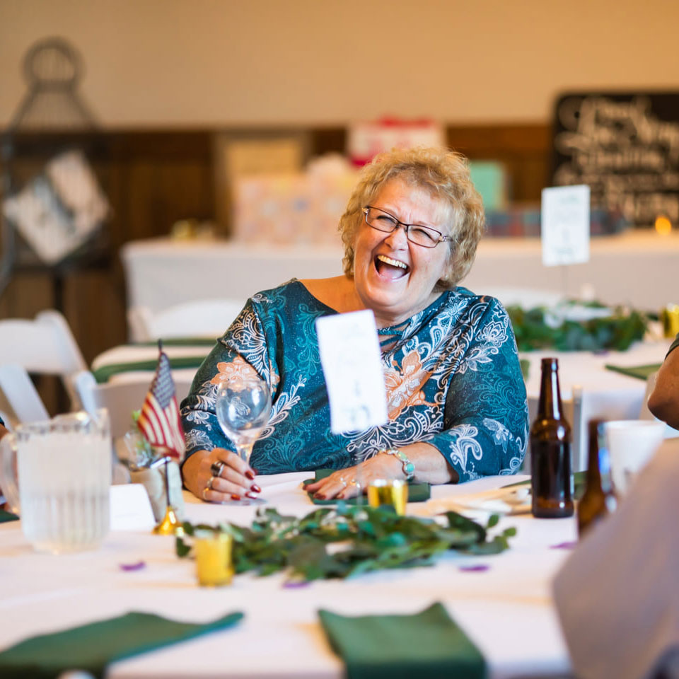 guest table woman laughing happily