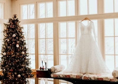 mansion study with beautiful christmas tree and wedding gown