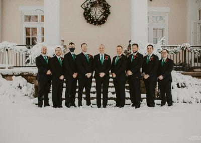 groomsmen portrait in front of the Ludlow Mansion Events front porch