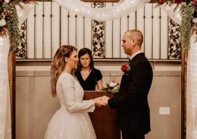 bride and groom in front of the altar in the Carriage Hall