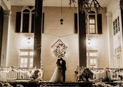 Ludlow Mansion couple on the front porch lit up at night