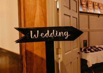 black wooden wedding sign indoors