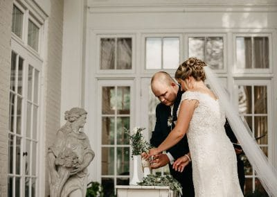 bride groom arranging plants