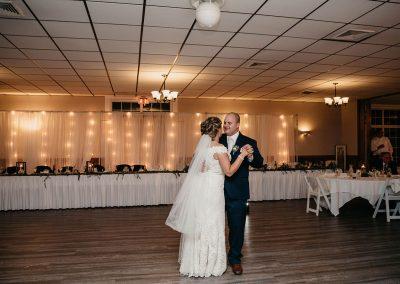 bride groom dance in dark lit room