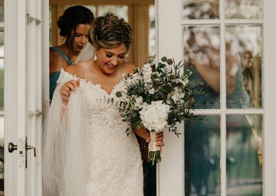 bride walk through glass doors